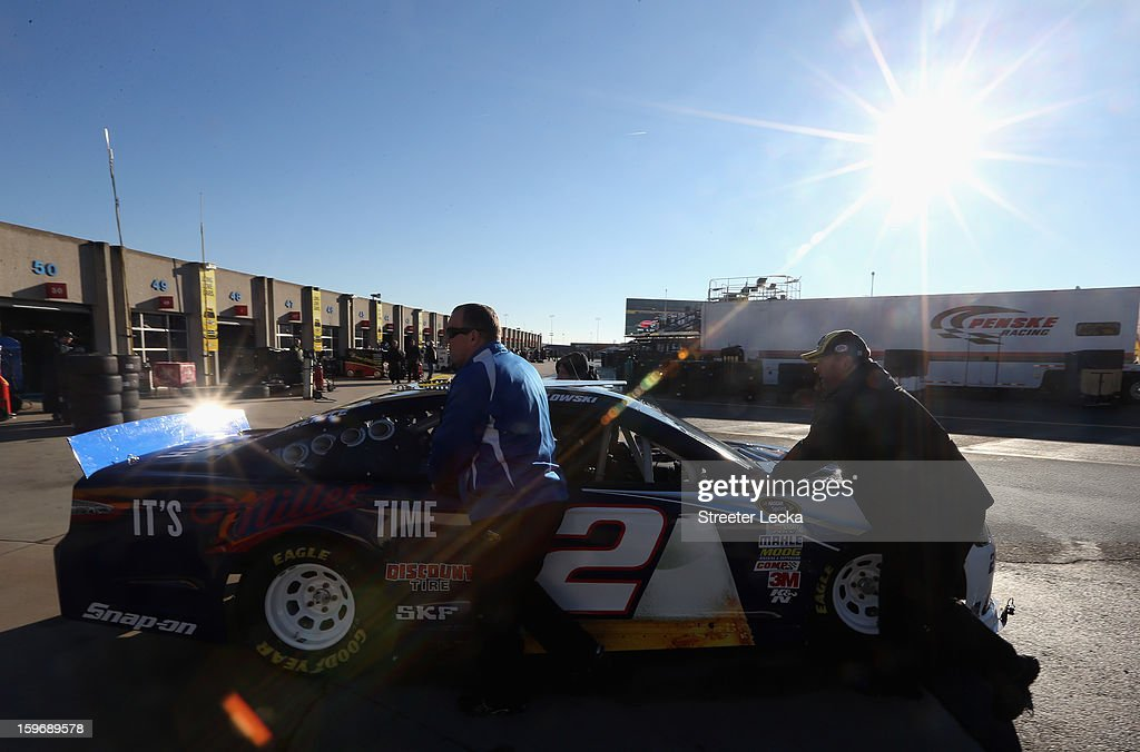 The car of <a gi-track='captionPersonalityLinkClicked' href=/galleries/search?phrase=Brad+Keselowski&family=editorial&specificpeople=890258 ng-click='$event.stopPropagation()'>Brad Keselowski</a>, driver of the #2 Miller Lite, is pushed through the garage area during NASCAR Testing at Charlotte Motor Speedway on January 18, 2013 in Charlotte, North Carolina.