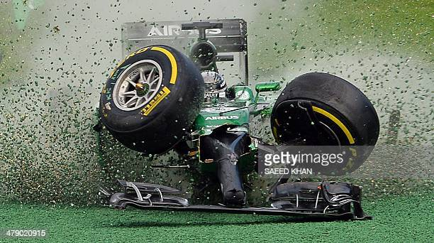 The car of CaterhamRenault driver Kamui Kobayashi of Japan veers off the track during an accident at the start of the Formula One Australian Grand...