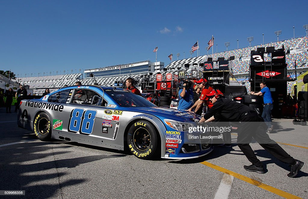 The car of Dale Earnhardt Jr. (not pictured), driver of the #88 Nationwide Chevrolet, is pushed by crew members through the garage area during practice for the NASCAR Sprint Cup Series Daytona 500 at Daytona International Speedway on February 13, 2016 in Daytona Beach, Florida.