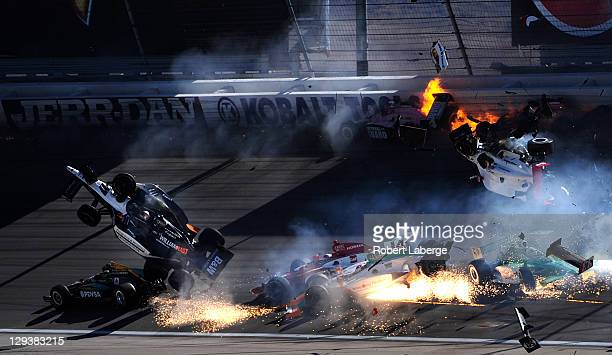 The car of Dan Wheldon of England driver of the Bowers Wilkins Sam Schmidt Motorsports Dallara Honda flies in the air during the Las Vegas Indy 300...