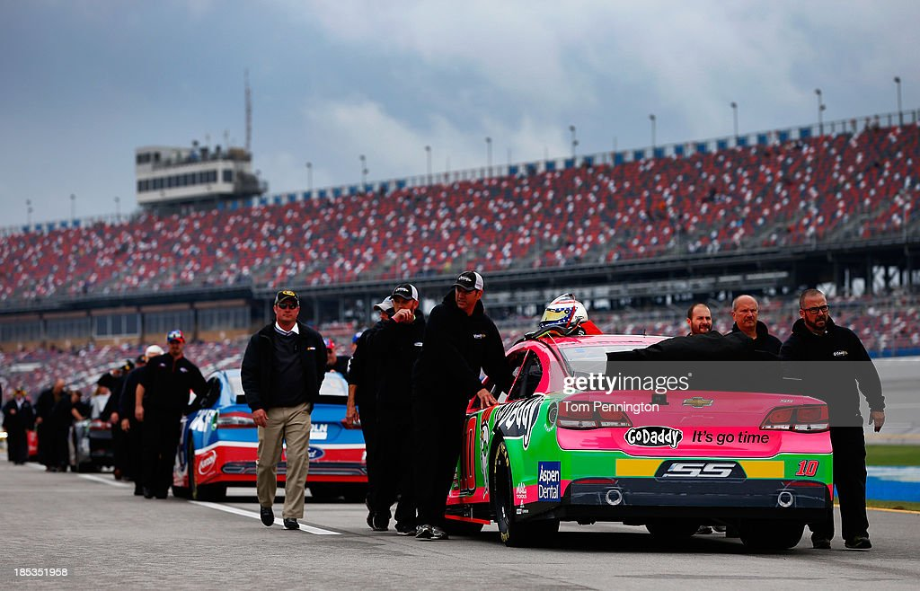 The car of Danica Patrick, driver of the #10 GoDaddy Breast Cancer Awareness Chevrolet, is pushed back to the garage after rain cancelled qualifying for the NASCAR Sprint Cup Series 45th Annual Camping World RV Sales 500 at Talladega Superspeedway on October 19, 2013 in Talladega, Alabama.