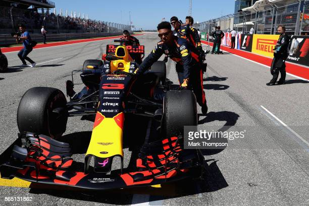The car of Daniel Ricciardo of Australia and Red Bull Racing is pushed on the grid before the United States Formula One Grand Prix at Circuit of The...