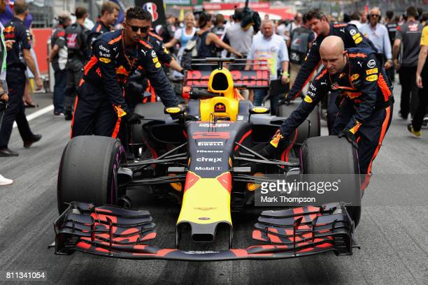 The car of Daniel Ricciardo of Australia and Red Bull Racing is pushed onto the grid before the Formula One Grand Prix of Austria at Red Bull Ring on...