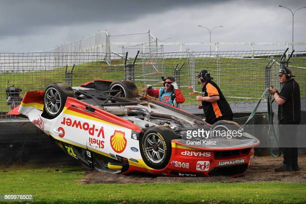 The car of Fabian Coulthard driver of the Shell VPower Racing Team Ford Falcon FGX is pictured after colliding with David Reynolds driver of the...