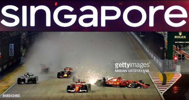 The car of Ferrari's Finnish driver Kimi Raikkonen is seen after a crash beside Ferrari's German driver Sebastian Vettel during the Formula One...