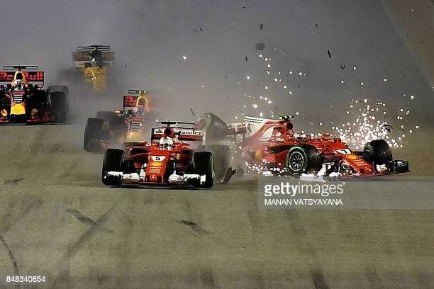 The car of Ferrari's Finnish driver Kimi Raikkonen is seen beside Ferrari's German driver Sebastian Vettel after a crash during the Formula One...