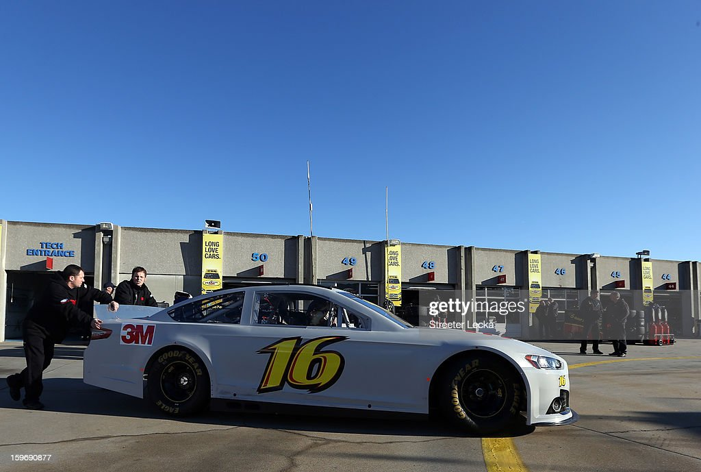 The car of Greg Biffle, driver of the #16 Ford, is pushed through the garage area during NASCAR Testing at Charlotte Motor Speedway on January 18, 2013 in Charlotte, North Carolina.
