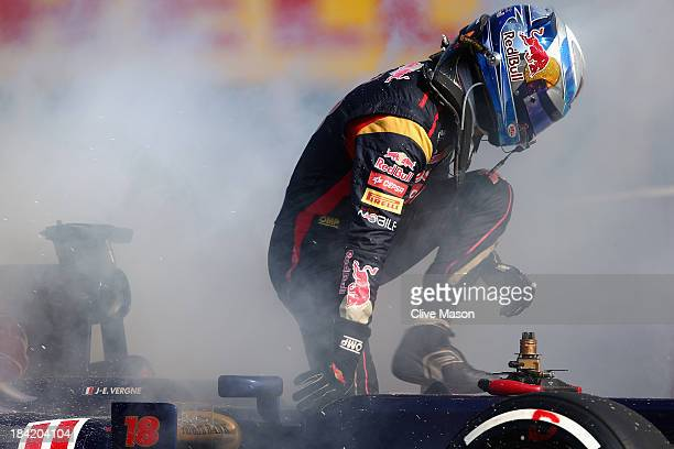 The car of JeanEric Vergne of France and Scuderia Toro Rosso catches fire during qualifying for the Japanese Formula One Grand Prix at Suzuka Circuit...