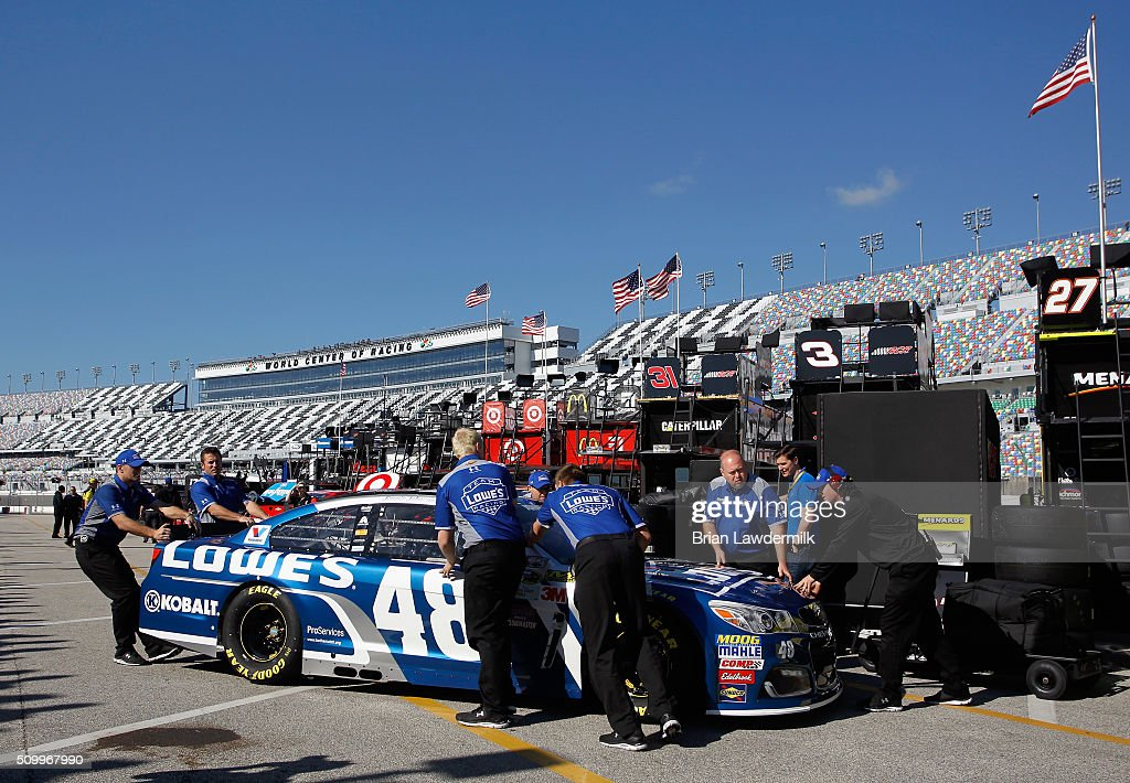 The car of Jimmie Johnson (not pictured), driver of the #48 Lowe's Chevrolet, is pushed by crew members through the garage area during practice for the NASCAR Sprint Cup Series Daytona 500 at Daytona International Speedway on February 13, 2016 in Daytona Beach, Florida.