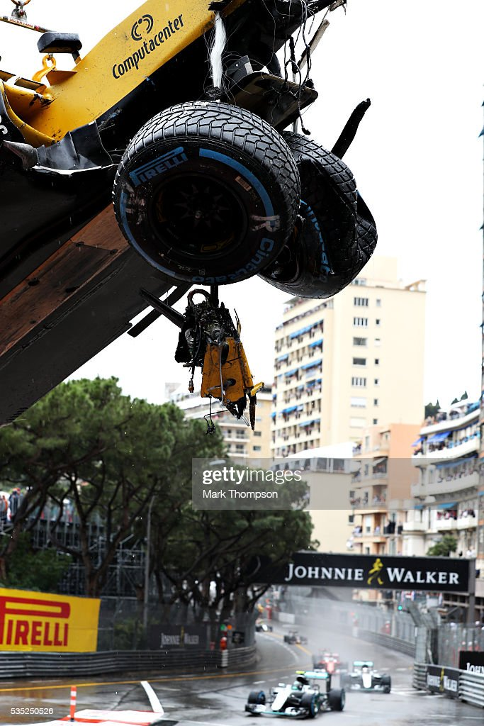 The car of Jolyon Palmer of Great Britain and Renault Sport F1 is removed from the circuit as the race continues during the Monaco Formula One Grand Prix at Circuit de Monaco on May 29, 2016 in Monte-Carlo, Monaco.