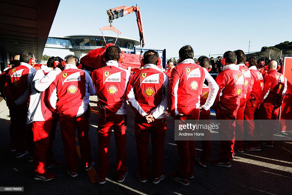 The car of Kimi Raikkonen of Finland and Ferrari returns to the pitlane on a flatbed truck after encountering a problem during day one of Formula One...