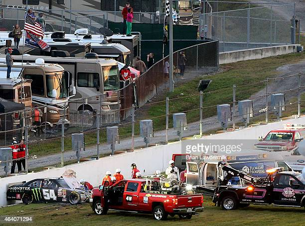 The car of Kyle Busch driver of the Monster energy Toyota is seen against a wall after crashing during the NASCAR XFINITY Series Alert Today Florida...