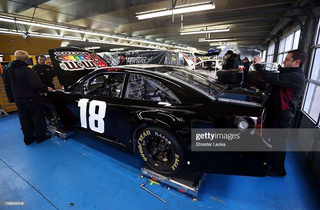 The car of Kyle Busch, driver of the #18 Toyota, sits in the garage during NASCAR Testing at Charlotte Motor Speedway at Charlotte Motor Speedway on January 17, 2013 in Charlotte, North Carolina.