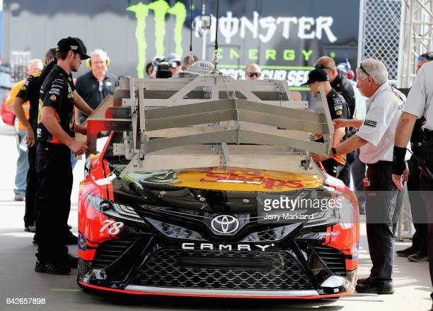 The car of Martin Truex Jr driver of the Bass Pro Shops/TRACKER BOATS Toyota goes through inspection during practice for the Monster Energy NASCAR...