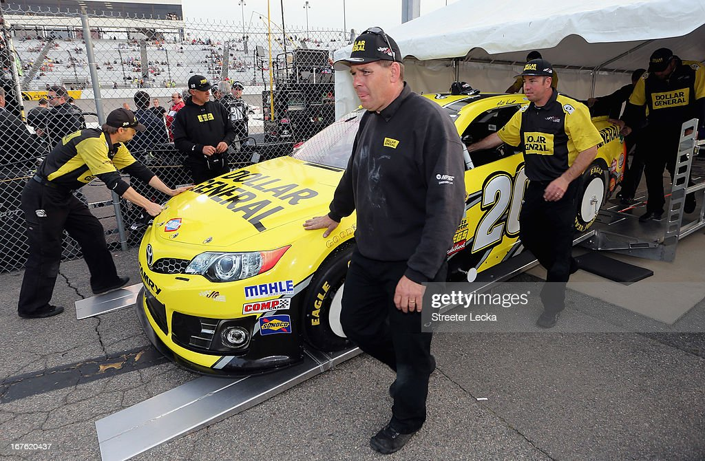 The car of Matt Kenseth, driver of the #20 Dollar General Toyota, is rolled away from technical inspection by the crew after qualifying on pole for the NASCAR Sprint Cup Series Toyota Owners 400 at Richmond International Raceway on April 26, 2013 in Richmond, Virginia.