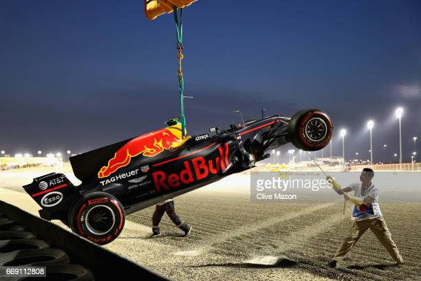 The car of Max Verstappen of the Netherlands driving the Red Bull Racing Red BullTAG Heuer RB13 TAG Heuer is removed from the circuit after he...