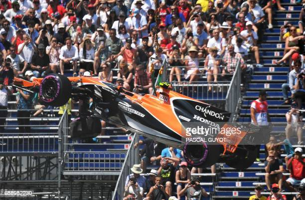 The car of McLaren's Belgian driver Stoffel Vandoorne is lifted by a crane after a crash during the qualifying session at the Monaco street circuit...