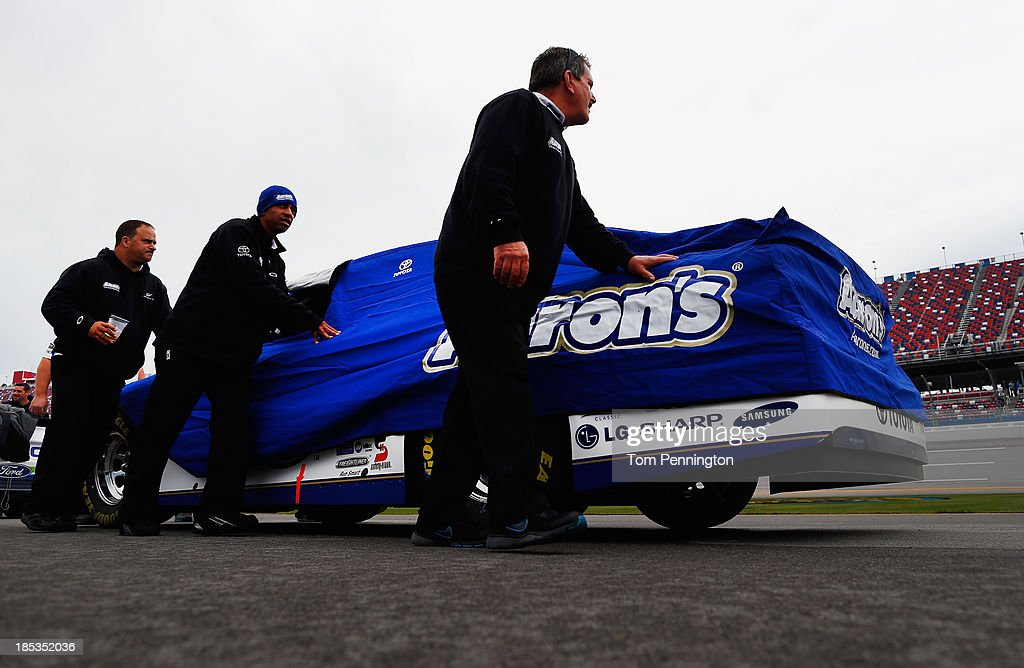 The car of Michael Waltrip, driver of the #55 Aaron's Dream Machine Toyota, is pushed back to the garage after qualifying for the NASCAR Sprint Cup Series 45th Annual Camping World RV Sales 500 ws cancelled due to rain at Talladega Superspeedway on October 19, 2013 in Talladega, Alabama.