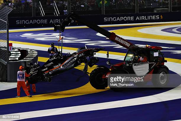 The car of Nico Hulkenberg of Germany and Force India is removed from the circuit during the Formula One Grand Prix of Singapore at Marina Bay Street...