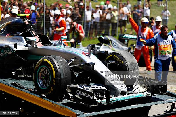The car of Nico Rosberg of Germany and Mercedes GP loaded onto a truck after crashing into Lewis Hamilton of Great Britain and Mercedes GP during the...