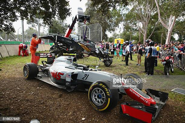 The car of Romain Grosjean of France drives the Haas F1 Team HaasFerrari VF16 Ferrari 059/5 turbo at the side of the track after a crash with...