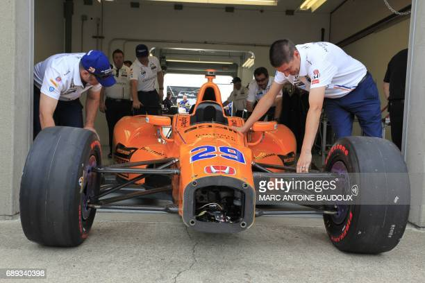 The car of Spanish driver Fernando Alonso gets its technical control before the start of the 101st Indianapolis 500 on May 28 in Indianapolis Indiana...
