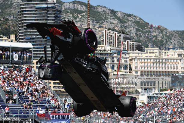 The car of Stoffel Vandoorne of Belgium and McLaren Honda is removed from the circuit during qualifying for the Monaco Formula One Grand Prix at...