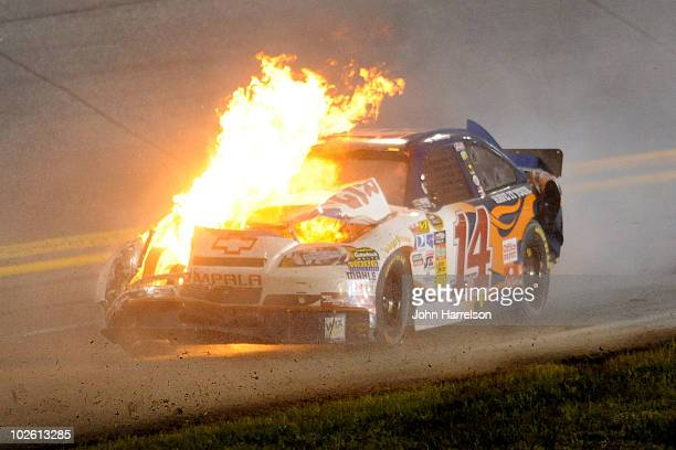 The car of Tony Stewart driver of the Burger King Chevrolet is engulfed in flames after crashing during the NASCAR Sprint Cup Series Coke Zero 400 at...