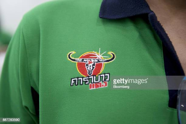 The Carabao Group Pcl logo is displayed on an employee's uniform at the company's plant in Chachoengsao Chachoengsao Province Thailand on Saturday...
