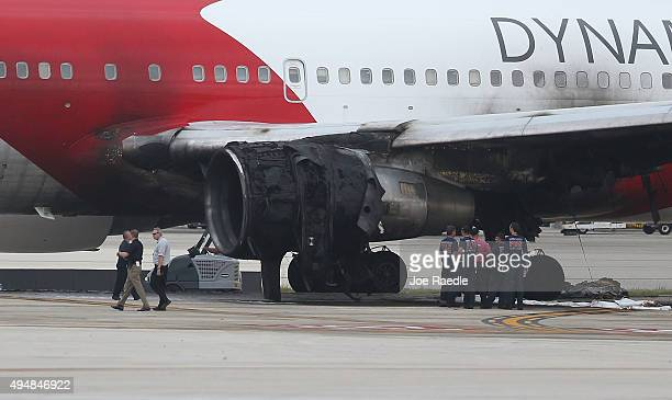 The Caracas Venezuelabound Dynamic International Airways Boeing 767 that caught fire sits on the runway at Fort LauderdaleHollywood International...