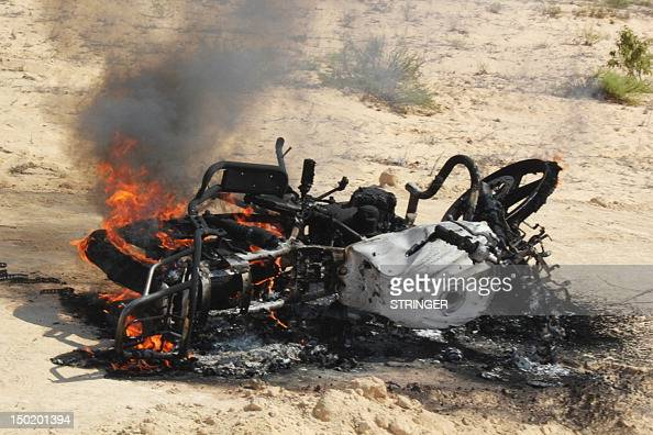 The carcass of a burning motorbike is pictured following a raid by Egyptian security forces on the village of elJurah in Egypt's Northern Sinai...