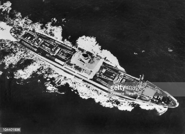 The cargo ship KIZIK HURCHATOV being photographed by an American reconnaissance plane as it leaves Cuba to return to Russia On the deck of this ship...