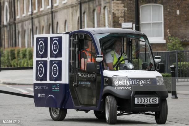 The CargoPod autonomous grocery delivery vehicle developed by Oxbotica Ltd drives under supervision of a safety steward during trials of the Ocado...