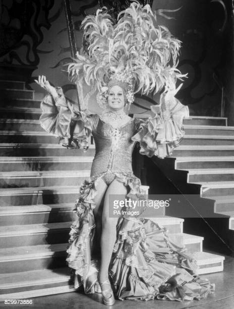 The Carmen Miranda look down Argentina way for Chinese laundry owner the Merry Widow Twankee alias female impersonator Danny La Rue pantomine dame in...