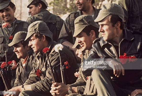 The carnation revolution in Lisbon Portugal in May 1 1974 The soldiers provoke a pacific putsch and put a carnation on their gun