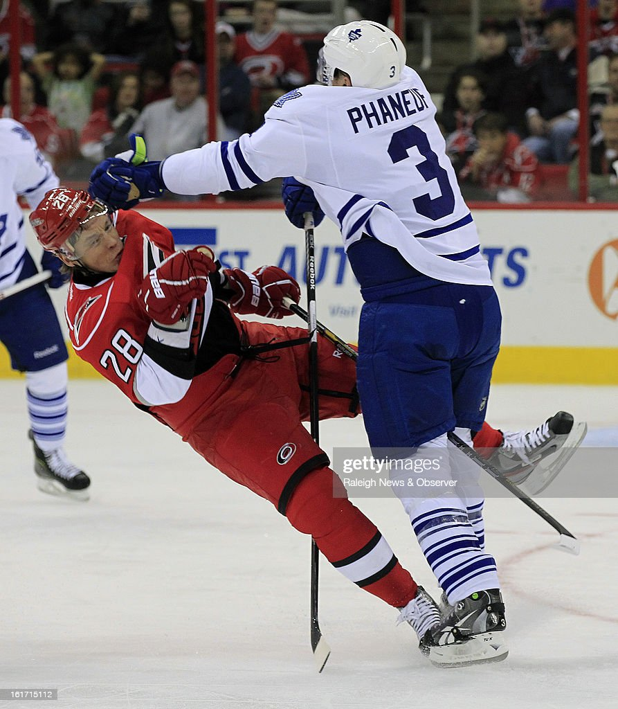 The Carolina Hurricanes' Alexander Semin (28) is hit by the Toronto Maple Leafs' Dion Phaneuf (3) during the first period at the PNC Arena in Raleigh, North Carolina, on Thursday, February 14, 2013.