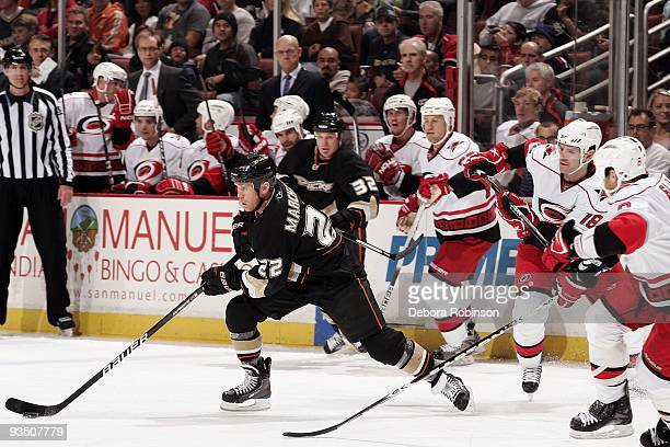 The Carolina Hurricanes defend from behind as Todd Marchant of the Anaheim Ducks drives the puck during the game on November 25 2009 at Honda Center...