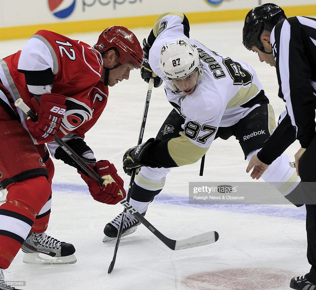The Carolina Hurricanes' Eric Staal (12) and the Pittsburgh Penguins' Sidney Crosby (87) battle for a face-off during the first period at the PNC Arena in Raleigh, North Carolina, on Thursday, February 28, 2013.