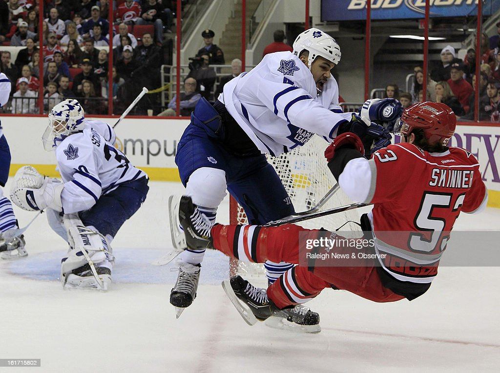 The Carolina Hurricanes' Jeff Skinner (53) is checked by the Toronto Maple Leafs' Mark Fraser (45) during the second period at the PNC Arena in Raleigh, North Carolina, on Thursday, February 14, 2013.