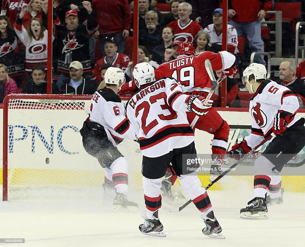 The Carolina Hurricanes' Jiri Tlusty (19) weaves around the New Jersey Devils' Andy Greene (6), David Clarkson (23) and Adam Larsson (5) to score an empty-netter during the third period at the PNC Arena in Raleigh, North Carolina, on Saturday, March 9, 2013. Carolina won, 6-3.