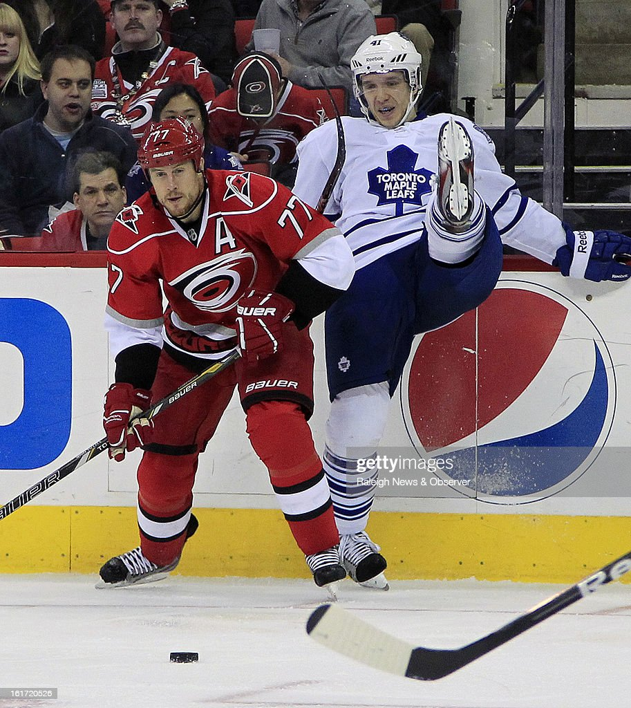 The Carolina Hurricanes' Joe Corvo (77) and the Toronto Maple Leafs' Cody Franson go for the puck during the second period at the PNC Arena in Raleigh, North Carolina, on Thursday, February 14, 2013. The Hurricanes won, 3-1.