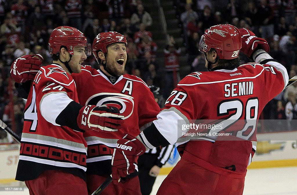 The Carolina Hurricanes' Joe Corvo, middle, celebrates his goal with teammates Bobby Sanguinetti (24) and Alexander Semin (28) during the second period against the Toronto Maple Leafs at the PNC Arena in Raleigh, North Carolina, on Thursday, February 14, 2013.