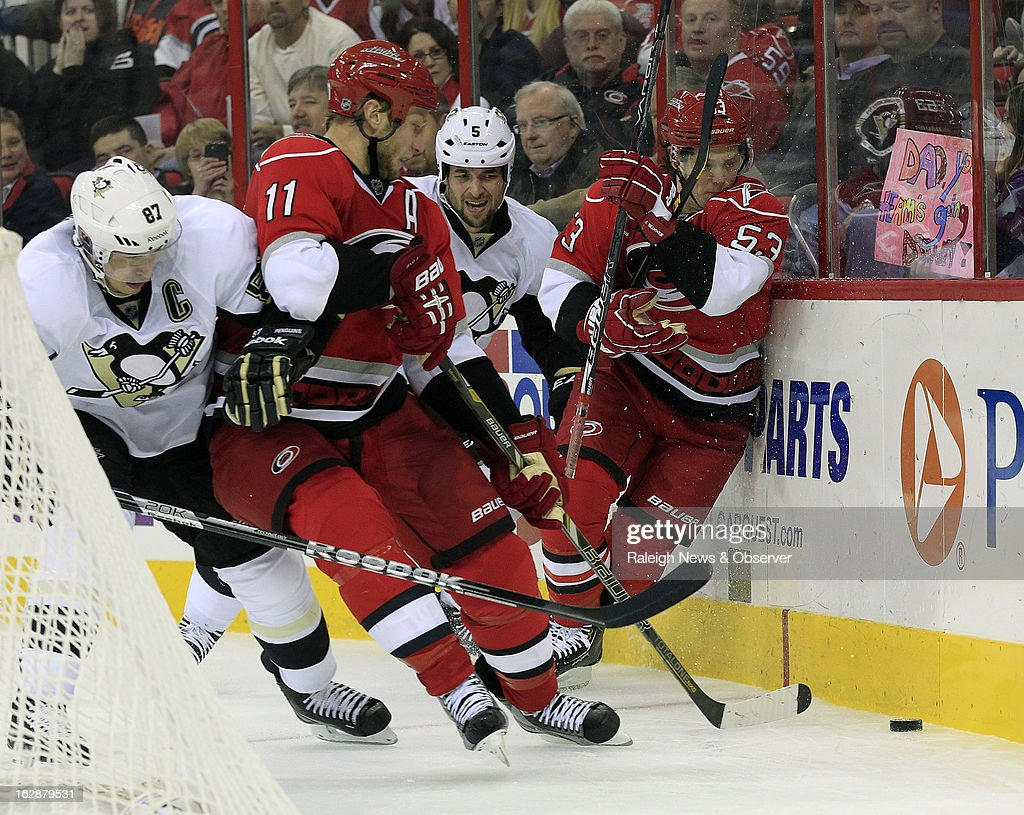 The Carolina Hurricanes' Jordan Staal (11) and Jeff Skinner (53) battle against the Pittsburgh Penguins' Sidney Crosby (87) and Deryk Engelland (5) during the second period at the PNC Arena in Raleigh, North Carolina, on Thursday, February 28, 2013.