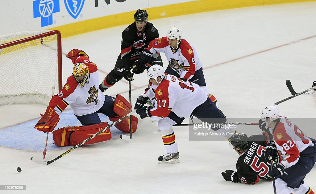 The Carolina Hurricanes' Jordan Staal (11) and Jeff Skinner (53) battle against the Florida Panthers' Scott Clemmensen (30), Filip Kuba (17), Stephen Weiss (9) and Tomas Kopecky (82) during the second period at the PNC Arena in Raleigh, North Carolina, on Saturday, March 2, 2013.