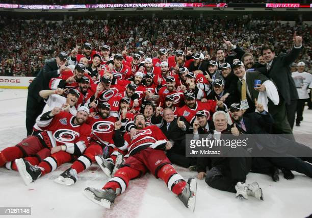The Carolina Hurricanes pose together with the Stanley Cup after defeating the Edmonton Oilers in game seven of the 2006 NHL Stanley Cup Finals on...