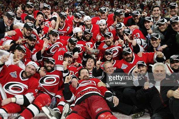 The Carolina Hurricanes pose with the Stanley Cup after defeating the Edmonton Oilers during game seven of the 2006 NHL Stanley Cup Finals on June 19...