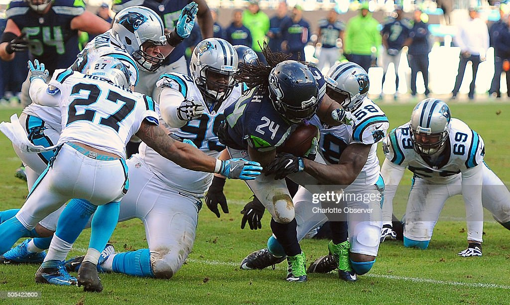 The Carolina Panthers defense makes the tackle on Seattle Seahawks running back Marshawn Lynch center during the fourth quarter on Sunday Jan 17 at...