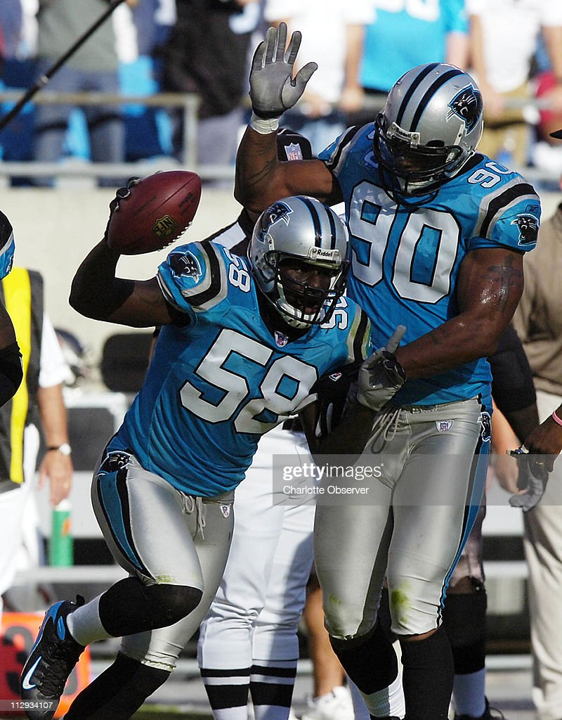 The Carolina Panthers Thomas Davis 58 celebrates with team