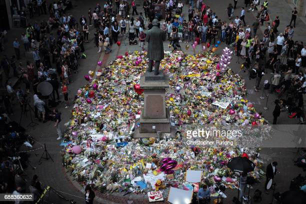 The carpet of floral tributes to the victims and injured of the Manchester Arena bombing covers the ground in St Ann's Square on May 25 2017 in...