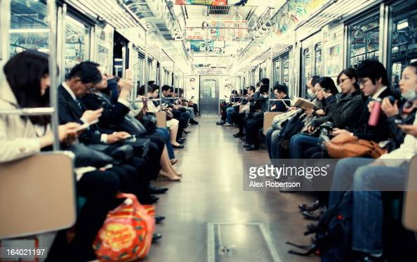 CONTENT] The carriage of a Tokyo subway train is full with seated commuters all absorbed in books and smartphones